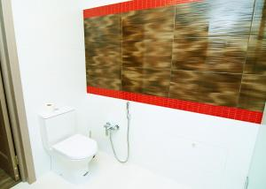 A bathroom at Q Apartment City Garden