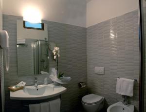 Salle de bains dans l'établissement Hotel Caravelle