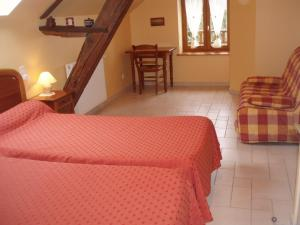 A bed or beds in a room at Chambres D'Hôtes De Froulay