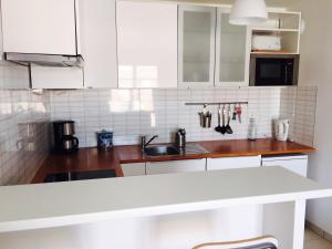 A kitchen or kitchenette at Magic Apartments