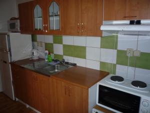 A kitchen or kitchenette at Apartmány U Stoiberů