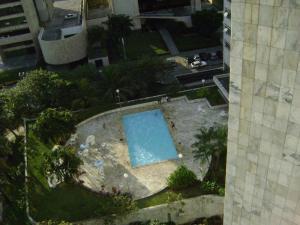 Uma vista da piscina em Flat no Hotel Imperial Suites ou nos arredores