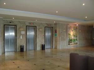 O saguão ou recepção de Flat no Hotel Imperial Suites