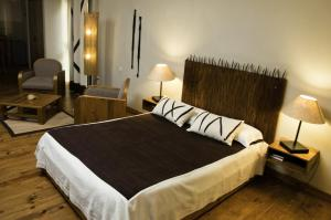 A bed or beds in a room at Le Combava