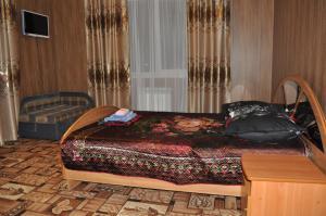 Кровать или кровати в номере Guest House Baykalskiy Ochag