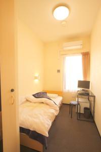 Tempat tidur dalam kamar di Hotel Palace Japan