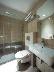Koupelna v ubytování Hotel Macola