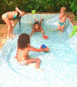 A piscina localizada em Hotel Eco Sítio Nosso Paraíso ou nos arredores