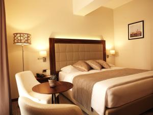 A bed or beds in a room at Grand Hotel Portoroz 4* superior – Terme & Wellness LifeClass