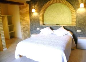 A bed or beds in a room at Casa Jabonero