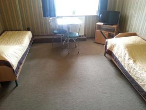 Łóżko lub łóżka w pokoju w obiekcie Max