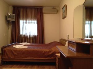 Кровать или кровати в номере Навигатор Отель