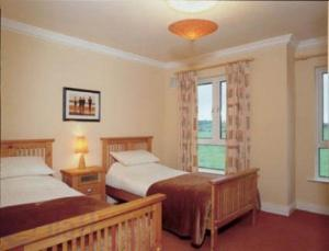 A bed or beds in a room at Mount Wolseley Holiday Home