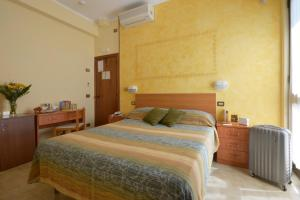 A bed or beds in a room at Albergo Martini