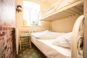 Кровать или кровати в номере Винтерфелл на Таганской