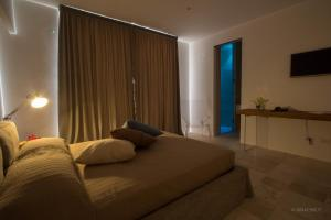 A bed or beds in a room at Calaporto-Holiday Home & Relax