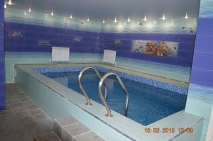The swimming pool at or near Guest House Yuzhnyy Express