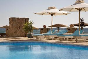 The swimming pool at or near Coral Coast Hotel