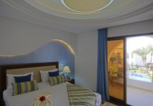 A bed or beds in a room at Palm Djerba Appartments