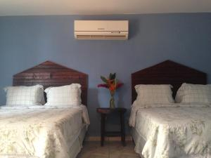 A bed or beds in a room at La Delphina Bed and Breakfast Bar and Grill