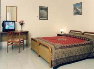 Letto o letti in una camera di Hotel Airone