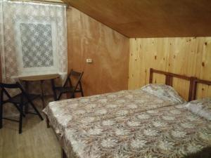 A bed or beds in a room at Bereg Baykala