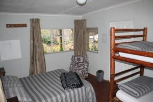 A bunk bed or bunk beds in a room at Backpackers Paradise and Joyrides