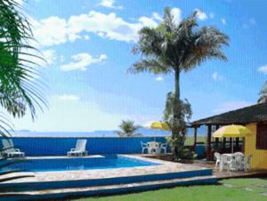 The swimming pool at or near Pousada Vistamar