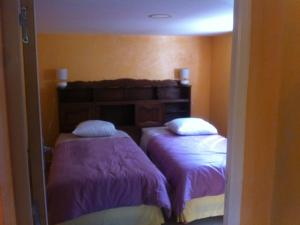 A bed or beds in a room at Gite Le Plessis
