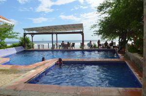 The swimming pool at or near Parque Maritimo El Coco