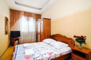 A bed or beds in a room at CENTRE! Lenina 3