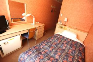 A bed or beds in a room at Yuzawa Royal hotel