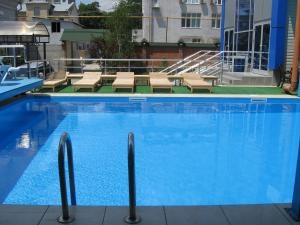 The swimming pool at or near Alexandrovskiy Hotel