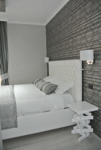 Letto o letti in una camera di B&B Insula Urbis