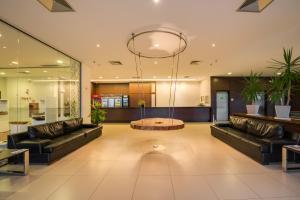 The lobby or reception area at Hotel Regente Paragominas