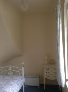 Un ou plusieurs lits dans un hébergement de l'établissement Chateau de Lucy