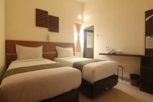 A bed or beds in a room at Hotel Pules