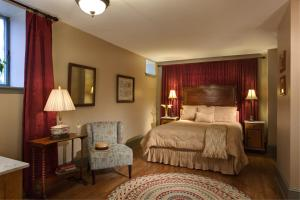 A bed or beds in a room at The Lafayette Inn