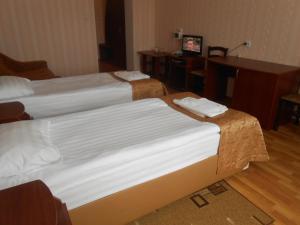 Кровать или кровати в номере Конгресс Отель Александров
