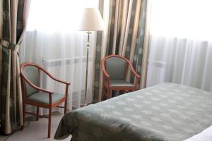 A bed or beds in a room at Maleton Hotel (Garibaldi)