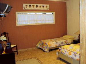 A bed or beds in a room at Hotel Fazenda Terra Ramos