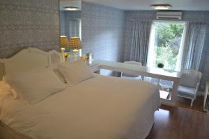 Cama ou camas em um quarto em Hotel Estalagem St. Hubertus