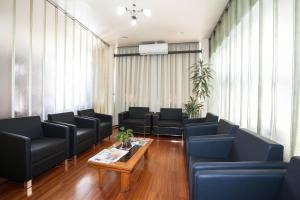 A seating area at Hotel Letto Caxias