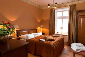 Ein Bett oder Betten in einem Zimmer der Unterkunft Palais Esplanade Hamburg