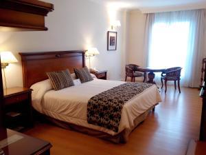 Cama ou camas em um quarto em Scala Hotel Buenos Aires