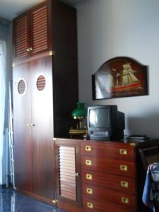TV o dispositivi per l'intrattenimento presso Appartamento Caponero