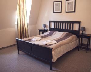 Postel nebo postele na pokoji v ubytování Hotel St.Michael