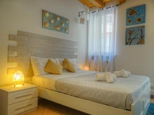 A bed or beds in a room at B&B Vicolo 22