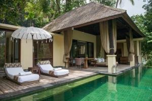 The swimming pool at or near Komaneka at Bisma Ubud