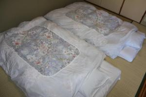 A bed or beds in a room at Bugakuso